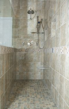 Porcelain tile shower with Danze thermostatic faucets.