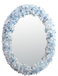 Hand carved wood frame with a hand painted silver finish, dressed with celestite good crystals and rock crystals.