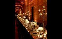 the breathtaking scale of this table highlighted the magnificence of this long space...perfect lighting and table decor adds to the splendor...www.feteny.com