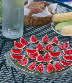 slice a lime in half and carve the fruit out. then fill with liquid watermellon jello and mini-choc chips and allow it to chill according to directions. then slice lime halves to get watermellon slices.