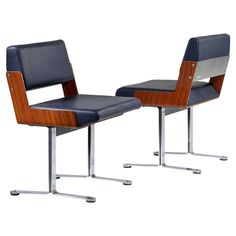 Pair of 1960s Chairs by Roger Tallon   From a unique collection of antique and modern chairs at https://www.1stdibs.com/furniture/seating/chairs/