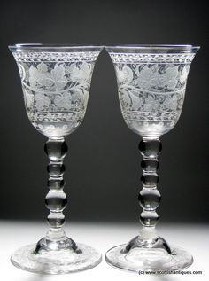 """Tall Pair of Victorian Engraved Glass Goblets c1880 Lipped round funnel bowls which are beautifully engraved with fruiting vines and bands of foliage Stem : Multiple Knops, """"bobbin stem"""" Foot : Domed and engraved Pontil : Snapped http://scottishantiques.com/bobbin-stem?filter_name=engraved#.VmC7LXbX5-c"""