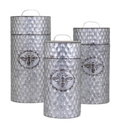 Features:  -Honey Bee collection.  -Set includes 3 canisters.  Function: -Decorative.  Product Type: -Canister.  Primary Material: -Metal.  Color: -Silver.  Set Size: -3.  Shape: -Cylinder.  Style: -A