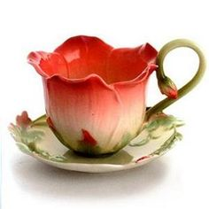 Whimsical tea cup and saucer !!! Love the contrasting colors and the delicate shooting bud handle.
