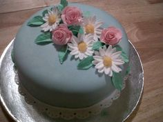 examples of 4 flowers or trims from latest Gum Paste and Fondant class.