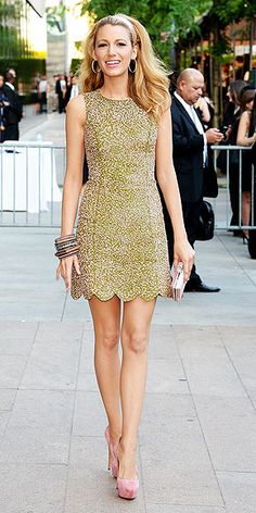 BLAKE LIVELY Legs (and hair) for days. The star selects an olive Michael Kors mini covered in pale-pink embellishments (which she told PEOPLE she loves) for the CFDA Fashion Awards. She adds salmon Casadei pumps, an enormous stack of bangles and a satin headband to hold back her voluminous waves.