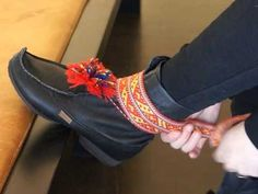 A short film [Swedish] about how to tie Saami shoe ribbons, made by Ájtte Svenskt Fjäll- och Samemuseum (Swedish Mountain and Saami museum) in Jokkmokk. Traditionally, made out of [animal] hides, nowadays braided/woven wool. Attach in shoe loops, wrap outwards. Tie closely around ankle to prevent snow and water from getting inside the shoe. Different areas make have different male/female ribbons. It is also common nowadays to stuff down ones pants into the shoes before tying the shoe…