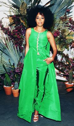 Solange Knowles wears a kelly green long dress over matching pants with Tamara Mellon heels