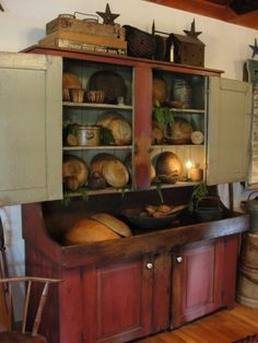 Prim Red Cupboard...old wooden dough bowls.