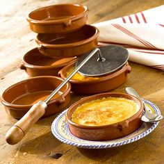 CREMA CATALANA DESSERT SET: Crema Catalana is the Spanish version of creme brulee. This creamy dessert with a caramelized sugar topping is fun to make & delightful to eat (6 x 4.5 inch Cazuelas plus Caramelizing Iron).