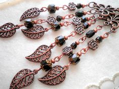 Antique copper earrings with black special cut glass crystals, copper flower beads and leaf pendants.    Length with hooks is 11cm (4,33inches).