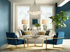 Home furnishings ideas living room blue wall color chandelier plant