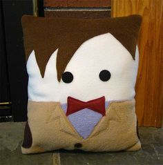 I know that many female Doctor Who fans would love to snuggle up with Matt Smith, the 11th Doctor. But since he's probably never going to show up in your home, here is the next best thing. A plush pillow that looks just like him.
