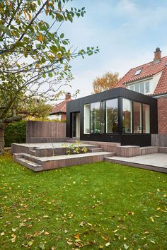 This elegant black box is an extension to a beautiful house. The extension solves the lack of space, that the owners experience. Extension Veranda, House Extension Design, Roof Ceiling, Home Exterior Makeover, Cheap Pergola, Pergola Kits, Roof Architecture, Box Houses, Pergola Attached To House