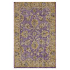 Pairing traditional style with contemporary color, this hand-knotted wool rug showcases a distressed Persian-inspired motif in purple.