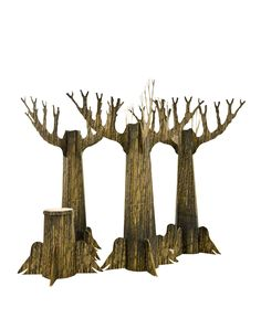 "Lifesize trees and stump set creates haunting real life forest effects!  $129.99  Recommended for indoor use  100% corrugated cardboard printed with realistic bark effect  H"" x L"" x D""- 9' x 3' x 3'  Includes three trees and one stump"