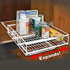 "SLIDING AND EXPANDING CABINET DRAWER - Fits cabinets 19"" deep. Expands 10 to 18W"". Coated wire. $24"