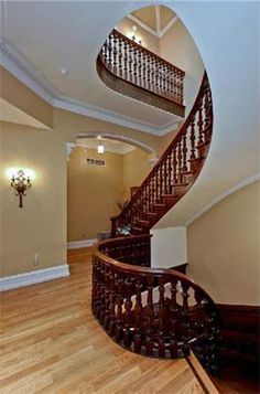 Love the carved timber balustrade on this staircase - the plain walls accentuate the stairs, further enhancing their beauty!