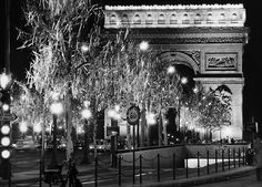 And of course, the iconic Arc de Triomphe in 1971 is truly regal during the holidays. | 13 Magical Vintage Photos Of Paris At Christmastime