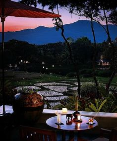 Dinner is served at @Four Seasons Resort Chiang Mai, complete with candles, rice paddies and a moonlit glittering lake.