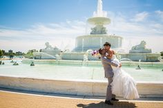 Groom lifts his bride in front of fountain on beautiful summer day #Michiganwedding #Chicagowedding #MikeStaffProductions #wedding #reception #weddingphotography #weddingdj #weddingvideography #wedding #photos #wedding #pictures #ideas #planning #DJ #photography #bride #groom