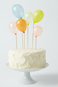 balloon decorated cake: use small water balloon sized balloons. blow them up & tie knot around wooden coffee stirrers or skewers
