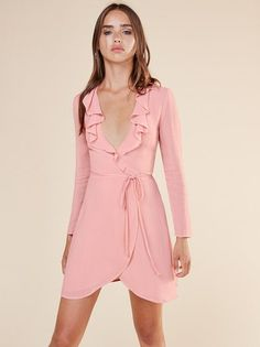 v femme. This is a mini length, wrap dress with a ruffle edged, low v neckline.
