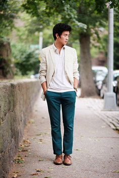 Teal pants with white shirt, cream jacket, and brown leather shoes