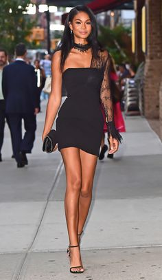 Chanel Iman in a one-sleeve black minidress