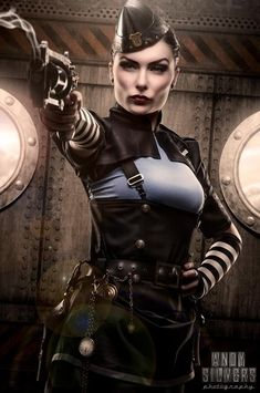 MARIA KURKOVA → Also simply known as THE HEADMISTRESS, is a Lumen of Russian deacend. She's an Alpha and the commanding officer in the British Royal Air Force. Maria is a very ruthless for a female Alpha, which makes her dangerous and feared among the enemy lines.