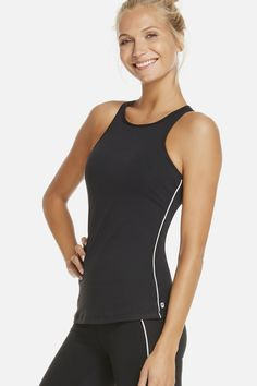 Fabletics Tanks Neve Tank Womens Black  This is not your average throw - and - go tank -- it's more! Pick up the pace and keep your girls in place with a built-in bra. You're welcome. Racerback Front And Back Styling, Contrast Piping On Side Seams, Shelf Bra With Removable Cups, Fit. Fitted, Length. Hip, Support. Medium, Fabric Content. 89% Polyester/11% Elastane . Fabletics Tanks Neve Tank Womens Black Size XXS