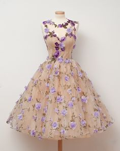 Vintage Fashion: Fabulous 50s inspired cream tulle dress adorned with lavender flowers. Designer: Chotronette