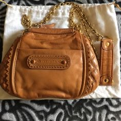 Juicy Couture Mini Crossbody Tan leather Crossbody bag with golden chain. this bag is in very good condition. No rips or marks. Top zipper closure. Inside bag has two slip pockets and back wall zipper pocket. Fit phone,car keys,small wallet  and lipstick Juicy Couture Bags Mini Bags