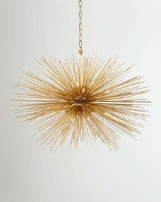 Handcrafted pendant light. Designed by Kelly Wearstler for Visual Comfort. Made of steel. Hand-painted gilt finish. Uses 20 60-watt bulbs. Ceiling canopy included. Direct wire; assembly and profession
