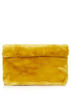 The standout Faux Fur Roll-Top Clutch for this look comes from topshop and is $50.00....