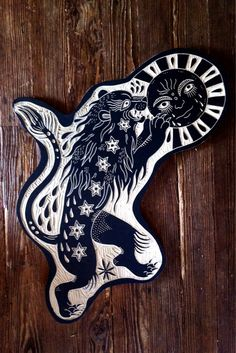 Lion eating the sun. Woodcut by Bryn Perrott