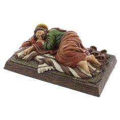 Sleeping Saint Joseph Figure - A man of silence and strength, the humble Saint Joseph sleeps peacefully as the work of God takes place. The Gospel of Matthew reminds us of Our Lord's voice whispering to Joseph while he rested in the night. Place your prayer requests under the statue and call upon the intercessory prayers of the foster father of Jesus. A favorite devotional of Pope Francis, this tradition reminds us to unite with Saint Joseph as he lifts up our petitions to God.