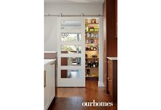 "A pantry was added to create versatile storage and hide small appliances.     See more of this home in ""House Breaks Designer's Cardinal Decorating Rule"" from OUR HOMES Niagara Spring 2017:  http://www.ourhomes.ca/articles/build/article/house-breaks-designers-cardinal-decorating-rule"