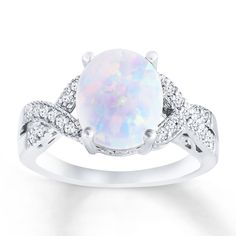 A colorful lab-created opal is accented by ribbons of lab-created white sapphires flowing along either side of this beautiful ring for her. The ring is styled in sterling silver. Opal Wedding Rings, Wedding Rings Vintage, Antique Engagement Rings, Opal Rings, Opal And Sapphire Ring, Silver Opal Ring, Green Opal, Rings For Her, Beautiful Rings