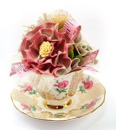 Teacup arrangement.  Filled with crafty flowers.