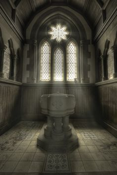 Baptismal font in an abandoned church.