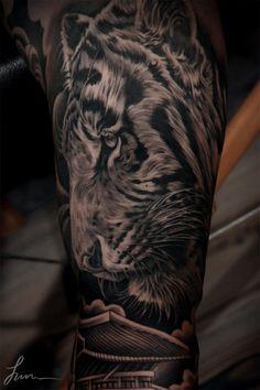 Amazing tiger tattoo by Jun Cha
