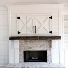 Rustic Farmhouse Fireplace In White Brick And Wood Sliding Barn Doors Hiding
