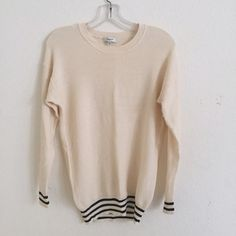 MADEWELL cream pullover Size XS but fits like a size S. A nice cream color with black stripe detailing on the bottom and sleeves. New without tags. Madewell Sweaters