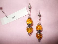 amber-colored acrylic bead with bead caps, daisy spacers and AB Swarovski crystals