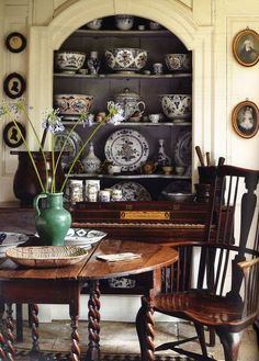 MUSIC ROOM - Would love to add built in shelves on either side of our Black Piano & add more dining dishes like these! Also need French expandable table for more dining guests. this table reminds me of Nana's LOVE the dark painted interior! French country manor. Dead link.