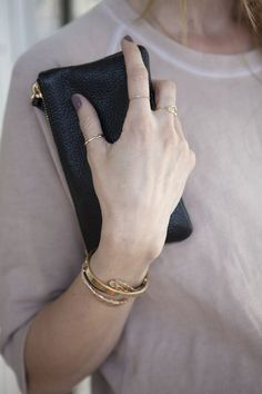 Neat gold plated bangles with tiny rings. The maximum amount of bling I'd like to wear this spring.