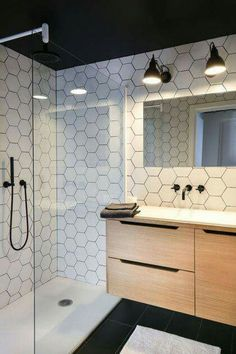 Love these white hexagon tiles amp; the black shower faucet Bathroom Tile Designs, Bathroom Interior Design, Bathroom Ideas, Bathroom Small, Bathroom Modern, Bathroom Black, Modern Shower, Master Bathroom, Black White Bathrooms