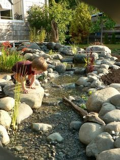 stream in backyard...maybe ending in small shallow pool/pond with pump recycling water back to top of stream?