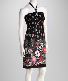 Slip into this fetching frock and sashay stylishly from storefront to seashore and everywhere in between. The abstract floral pattern lends eye-catching appeal to the look, while the stretchy, fitted halter top ensures it's as fashionable as it is flattering.Measurements (size L): 30'' long from center back neckline to hem90% polyester / 10% spandex<...